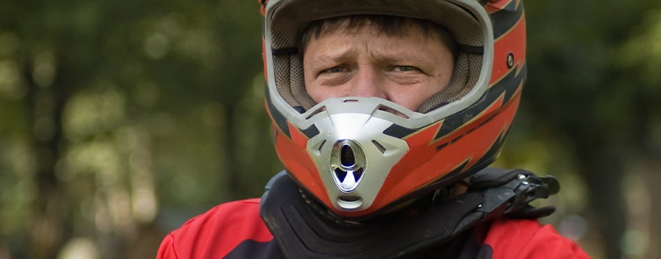 Geared up rider with motocross neck brace