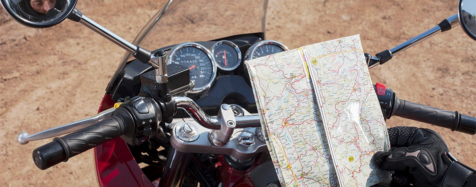 Motorcyclist reading a map