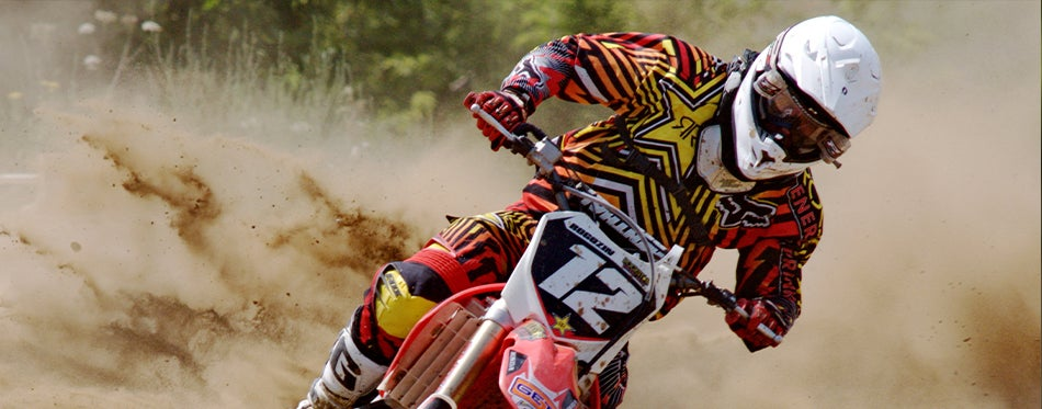 Racer with motocross neck brace in the dirt