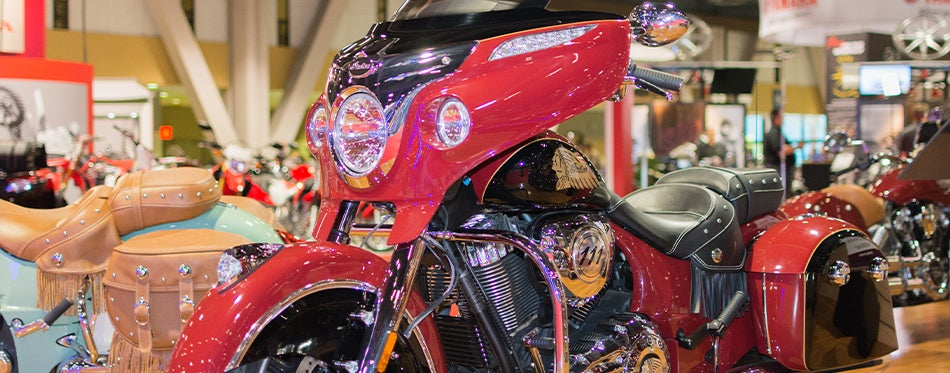 Red motorcycle with batwing fairing at expo