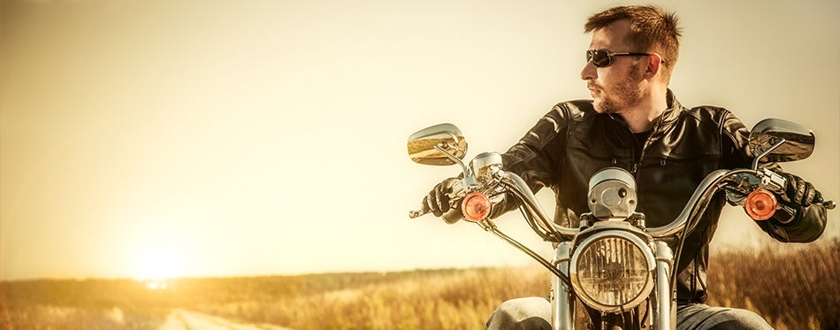 Young man riding his motorcycle in high temperatures