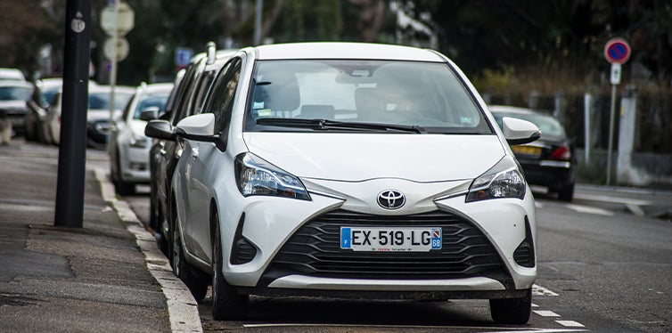 Front view of Toyota Yaris hatchback parked on the street