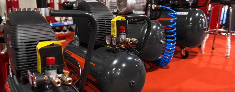 Shop air compressors lined up at the store