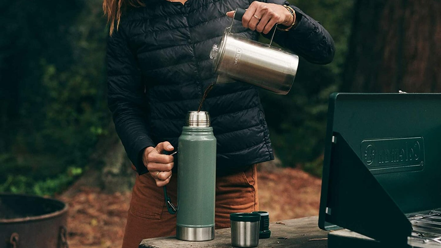 Man using a Coffee Thermos