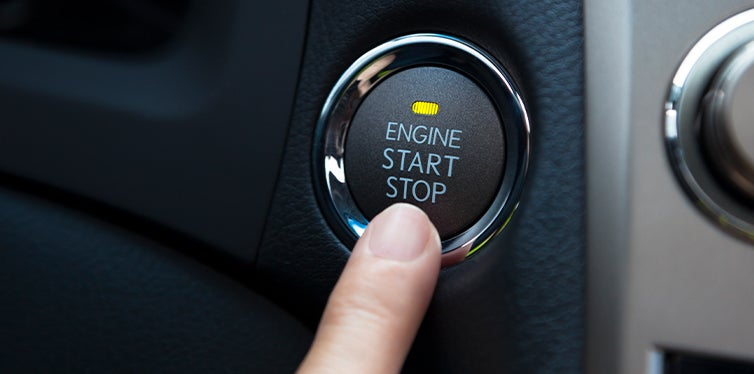 Driver initiating car starter with start button
