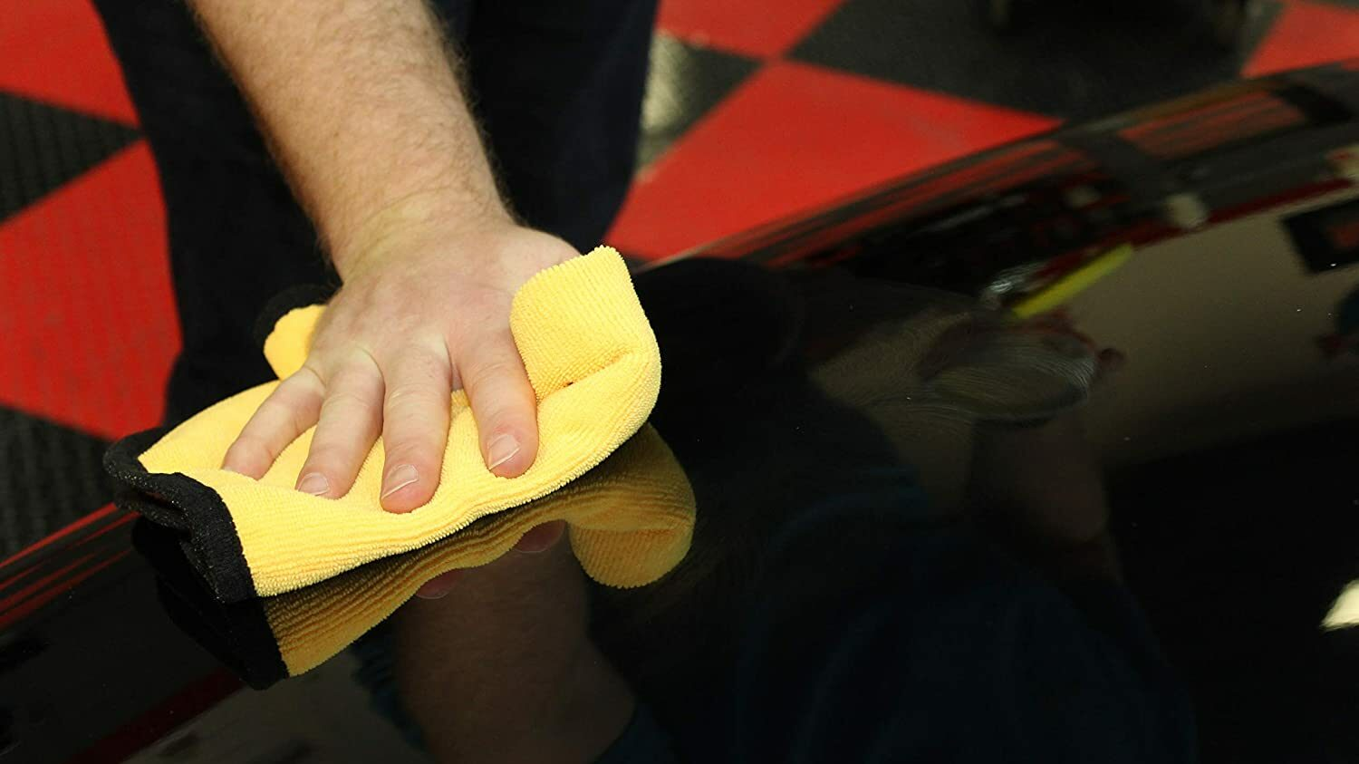 Detailing a car with paste wax