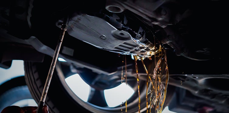 Mechanic changing and flushing the transmission fluid
