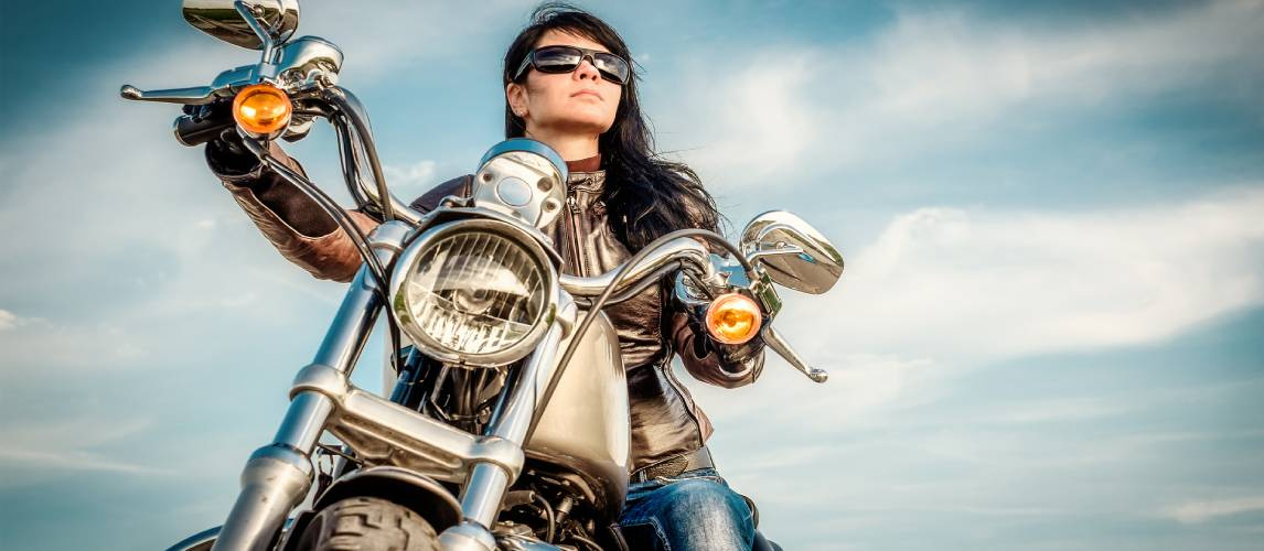A girl on a bike with Women's Motorcycle Jacket