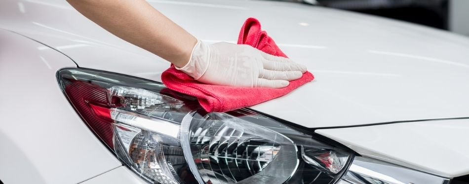 Worker Waxing White Car