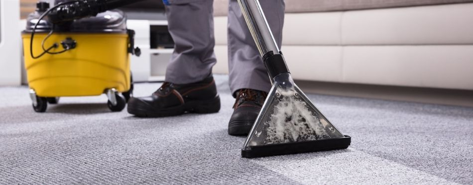 Man Using Carpet and Upholstery Cleaner