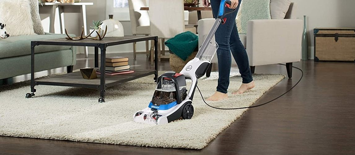 Woman Using Carpet and Upholstery Cleaner