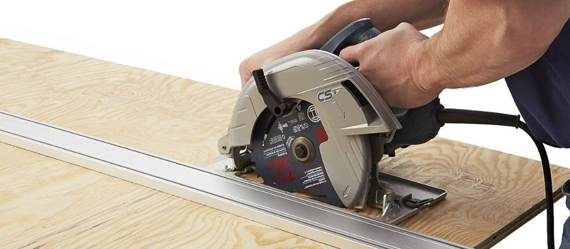 Man Hands Holding Circular Saw Guide