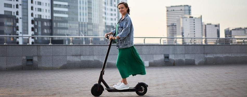 Woman Riding An Electric Scooter For Heavy Adults