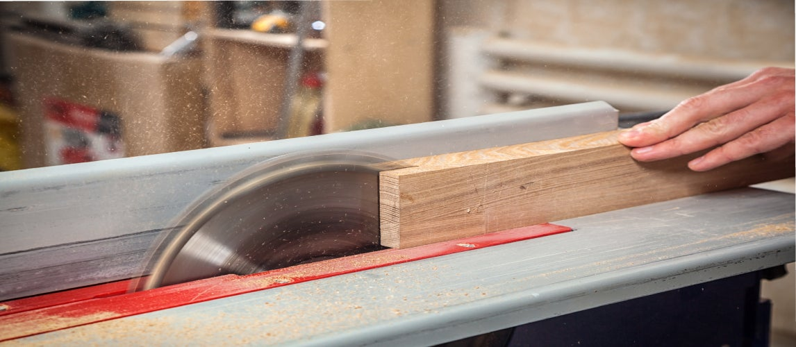 A table saw being used in a workshop