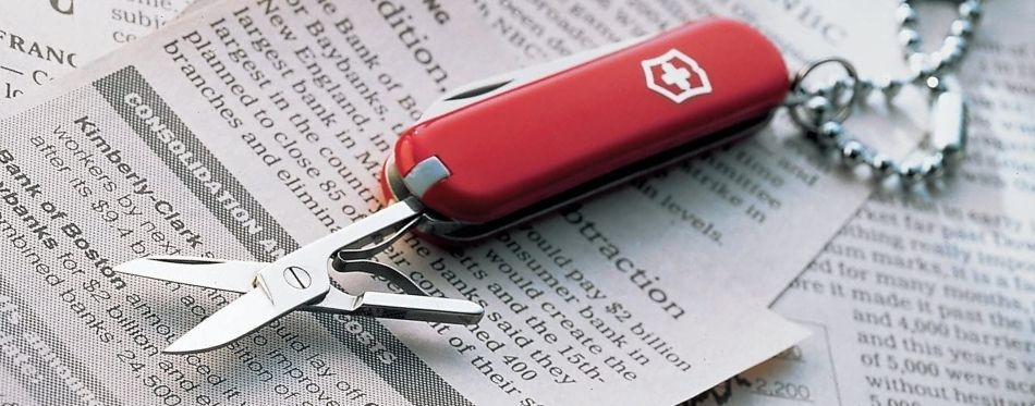 Keychain multitool on the top of newspapers