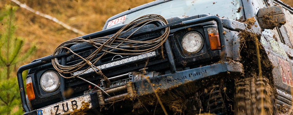 Nissan Patrol using UTV winches to get out