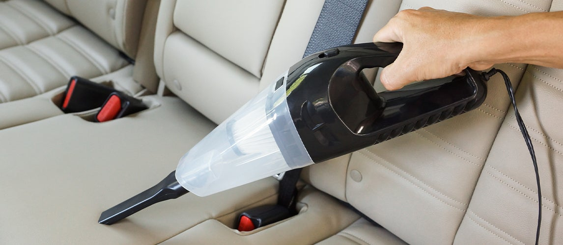 Cleaning Car Seats with Portable Vacuum Cleaner