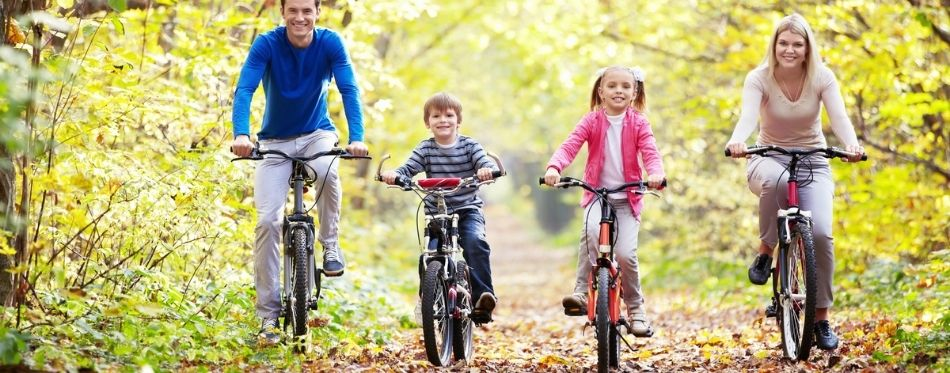 Kids riding 20 inch bikes with their parents