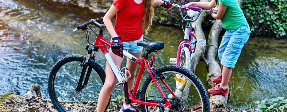 Girls passing over the river with their 20 inch bikes