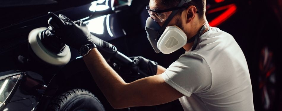 Polishing car with buffing compound