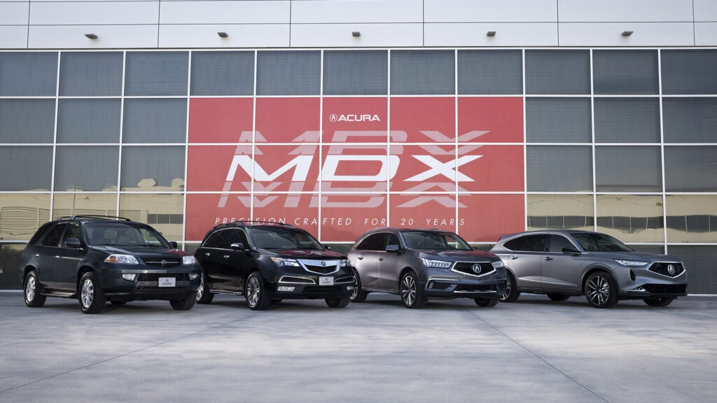 All four generations of the Acura MDX lined up in a row.