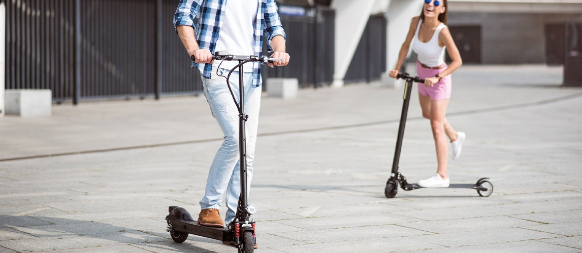 Couple Using Best Electric Scooters With a Seat