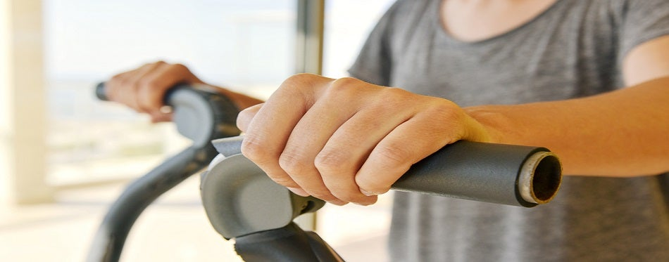 young man using an elliptical trainer