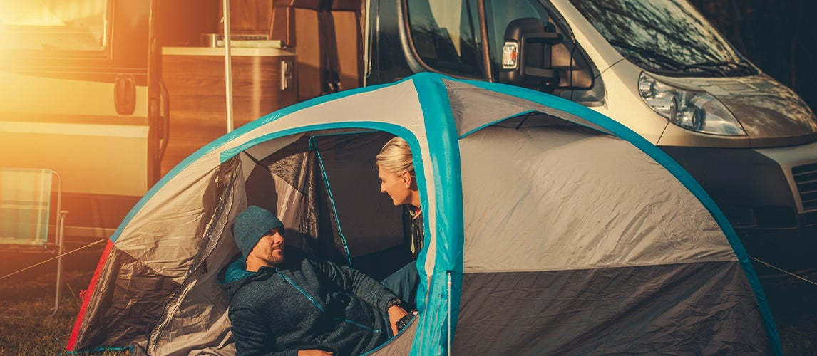 couple enjoying the sunset with the best van tent