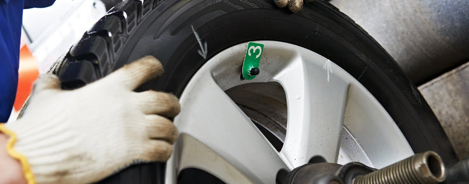worker trying to repair 205/55R16 Tires