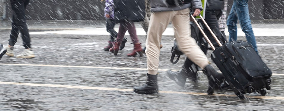 walking on rain with the best rolling backpacks