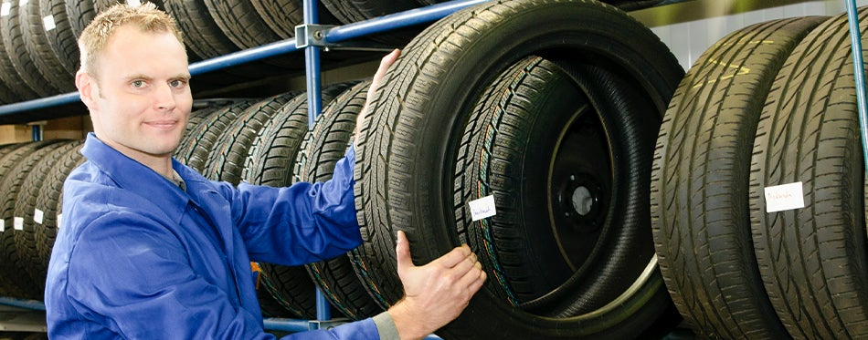 worker taking the best 205/55R16 Tires