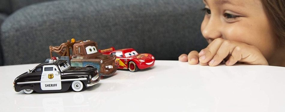 Kid playing with diecast cars