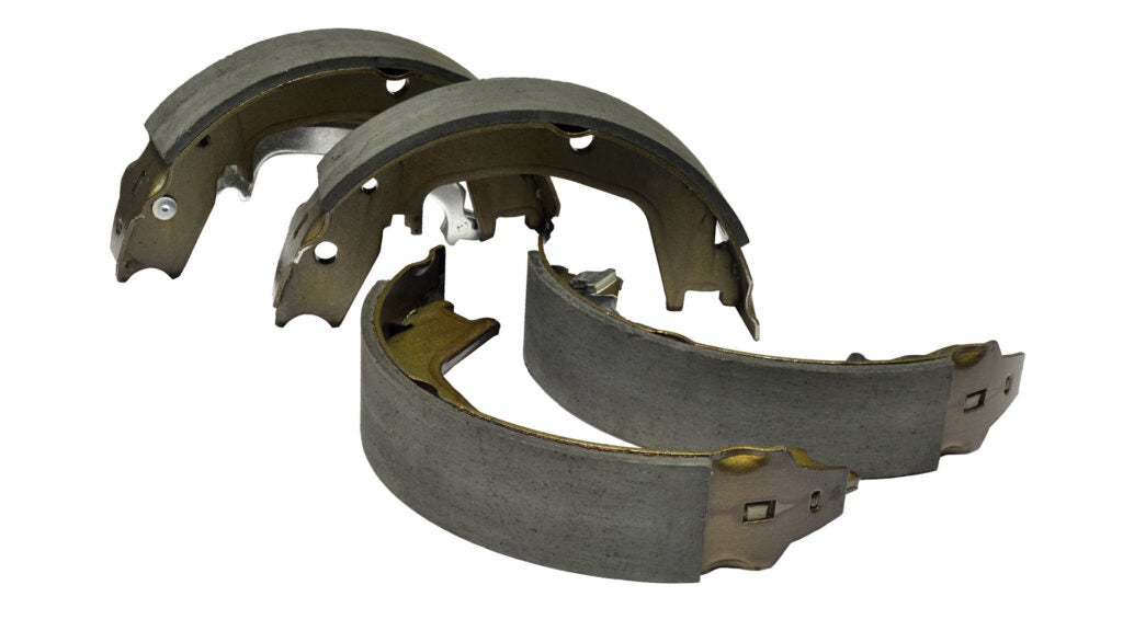 Drum brake pads on a white background.