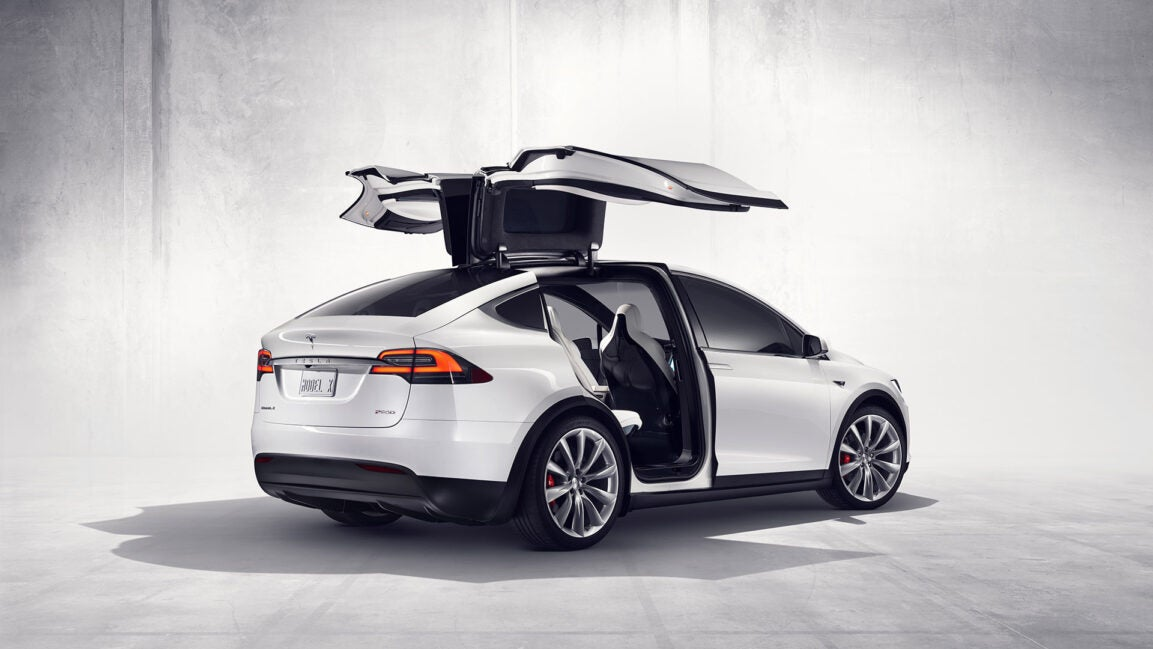 A white Tesla Model X on a light background.