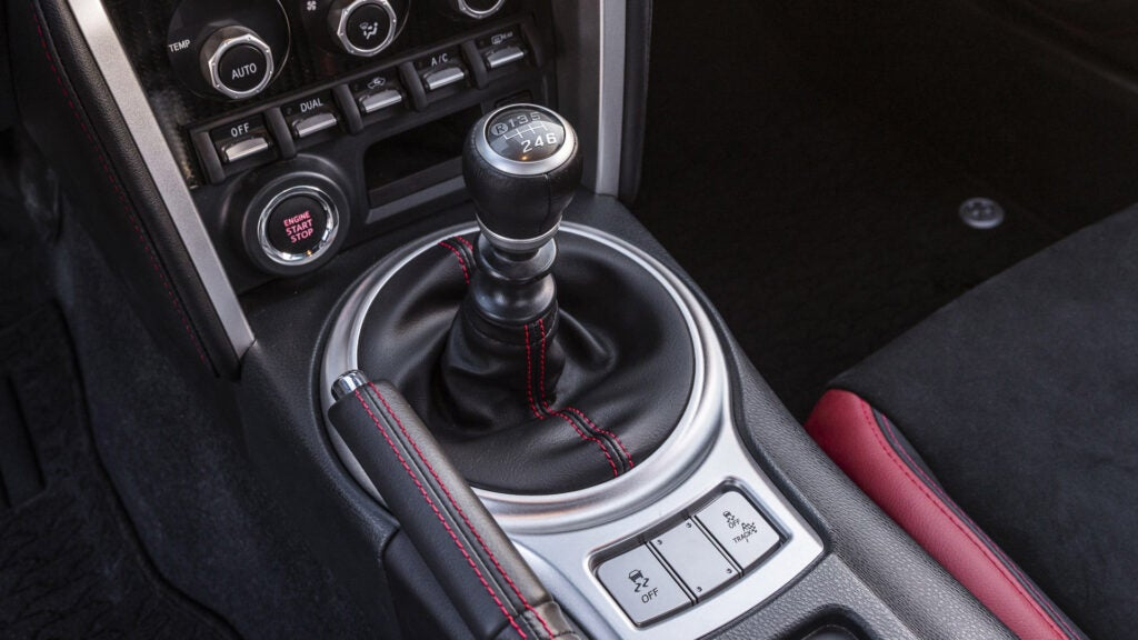 A Toyota 86 is equipped with a manual shifter.