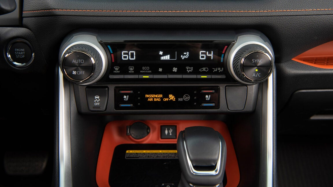 Stability control buttons and the VSC light inside of a car.