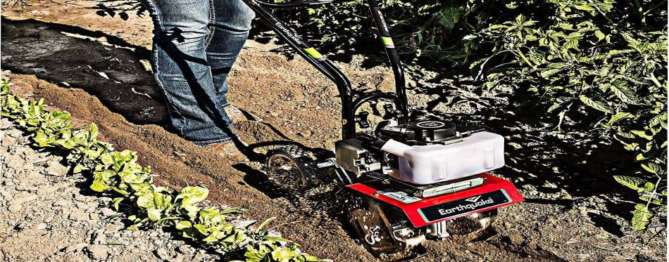 Working in the garden using cultivator
