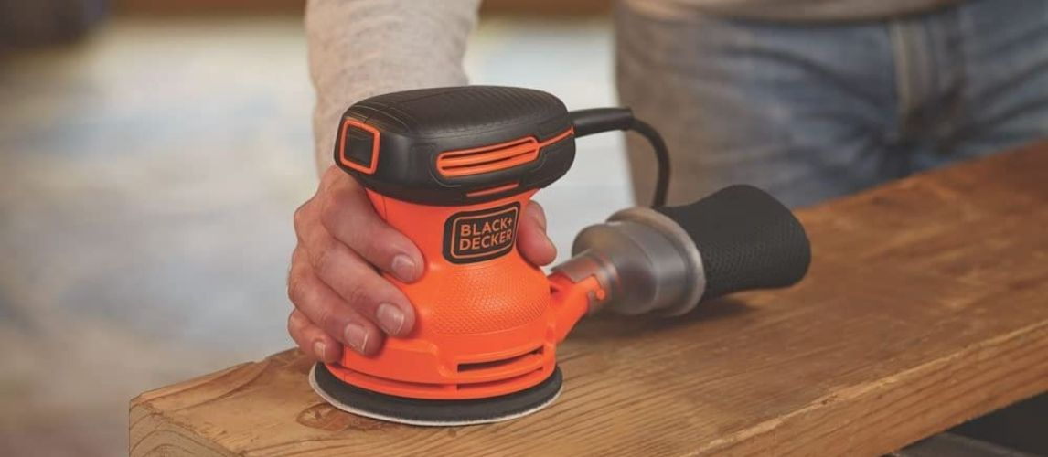 Man working with electric sander