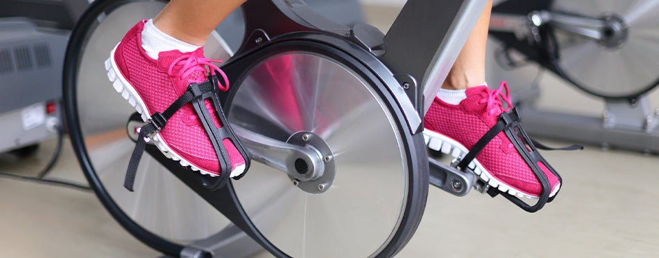 girl at the gym using spin bikes
