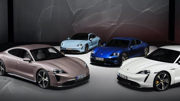 A colorful assortment of Porsche Taycans on a dark backdrop.
