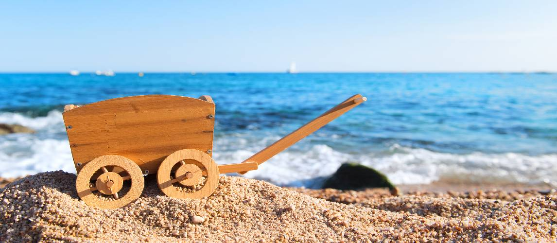 Vintage hand cart for vacation luggage at the beach