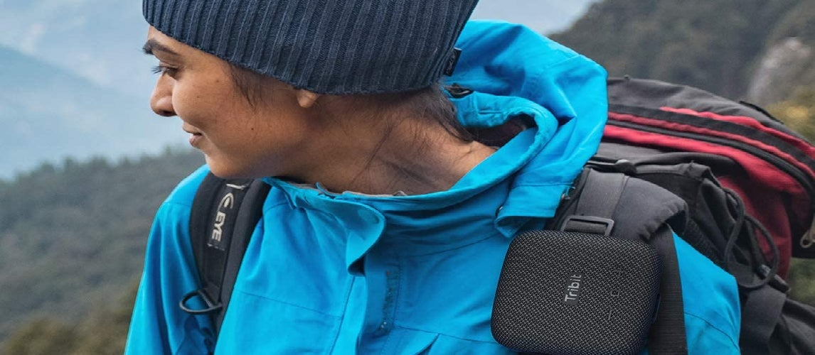 Women carrying with her Bike Speakers