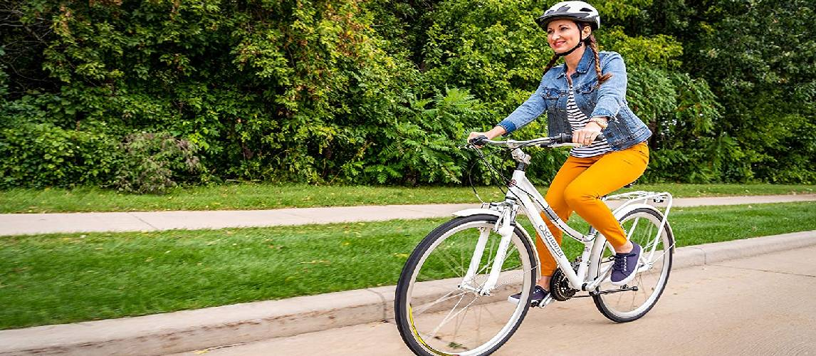 Woman rides a comfort bike in park