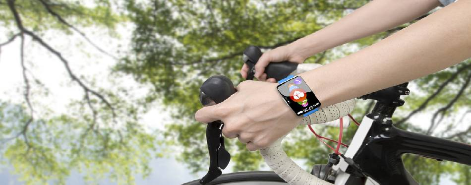 Cyclist is wearing the smartwatch while is riding a bike