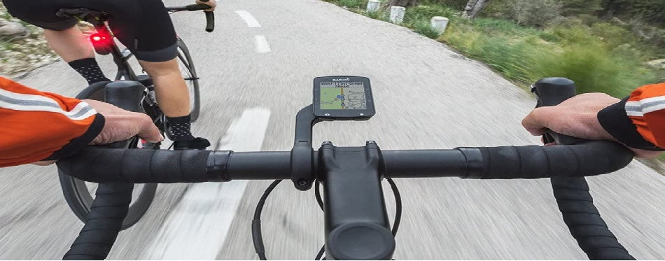 Cyclist riding a bike with GPS attached on the wheel