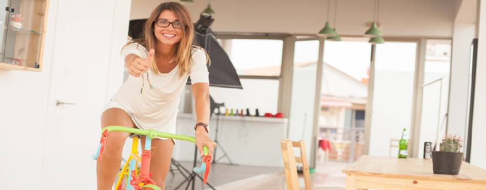 Young woman with bicycle home concept