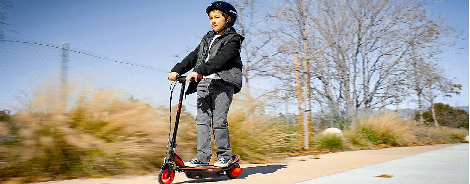 A boy is riding the Razor Electric Scooter
