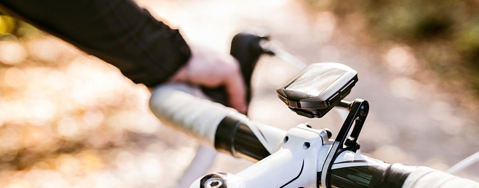 Sportsman riding his bicycle using the best bike speedometers