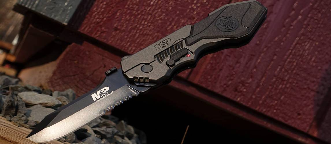 Pocket knife stabbed into a wood