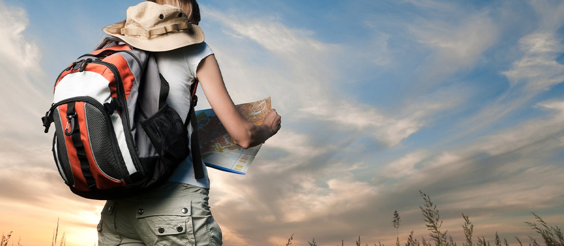 Young woman with backpack coolers